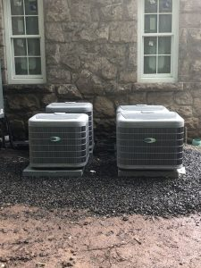 Four Carrier Air Conditioners Outside a Home