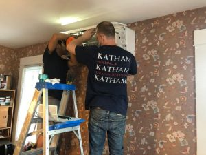 Two Katham Industries Service Technicians Install a Ductless HVAC Unit