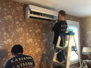 One Katham Industries Service Technician Installs a Ductless HVAC Unit