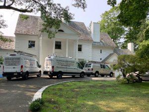 Three Katham Industries Service Vehicles at a job site